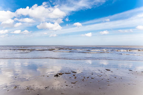Clouds and beach at low tide