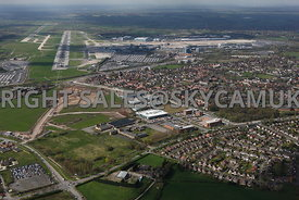 Manchester high level aerial views of Manchester Airport showing  Terminal buildings and runways and Ringway Trading Estate and the old Ferrantic Electronics factory Simonsway Wythenshaw