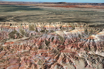 Painted Desert Badlands, Ward Terrace and Moenkopi Plateau at the horizon.  Arizona, USA.
