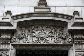 Lion head carving above window on side wall of government palace, Lima, Peru