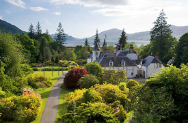 View over house to Loch Carron to Isle of Skye; Beinn na Caillich is largest hill on horizon