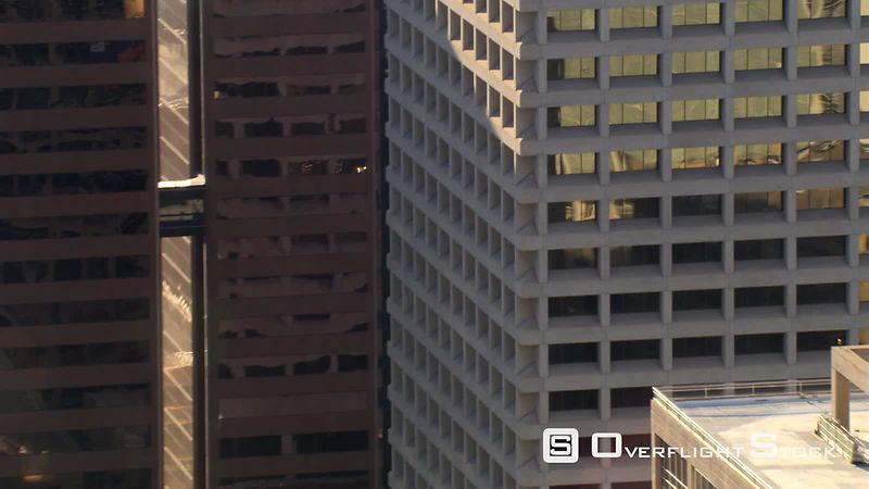 Close flight past layered skyscrapers in downtown Phoenix.