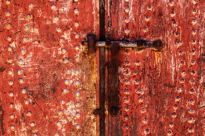 Closeup of a Textured Red Door
