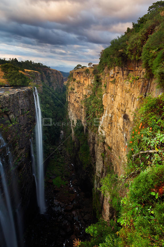 Waterfall over deep, narrow gorge. Magwa Falls, Pondoland, Eastern Cape, South Africa. June 2012.