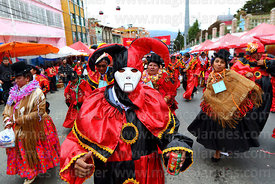 Pepino with white face mask dancing during parades for the Entierro del Pepino, La Paz, Bolivia