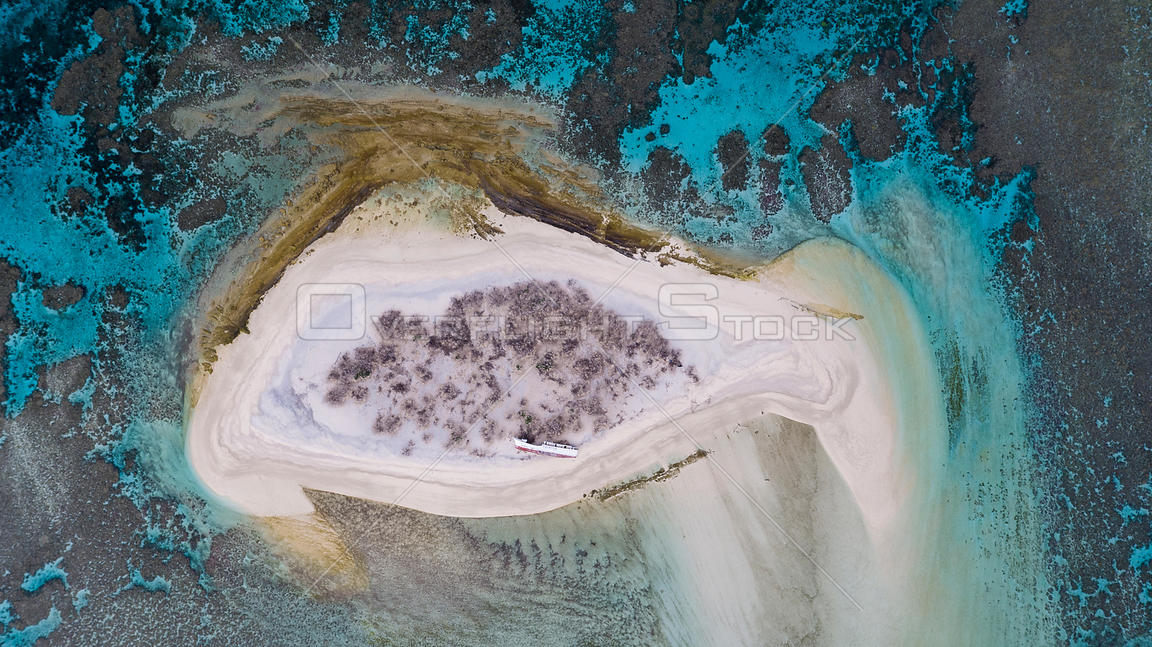 Aerial view of wreck of a of longlining fishing boat on Ceva-I-Ra Reef also known as Conway Reef a small coral reef atoll in the republic of Fiji. .