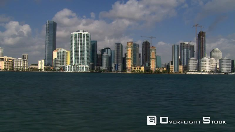 Low flight past Miami skyscrapers along Biscayne Bay.