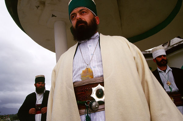 Bektashi Dervishes in the grounds of their orders' house in Tirana Albania. The Bektashi's are an order of Sufi's, Muslim mystics and were persecuted along with all other religions under the Communist regime