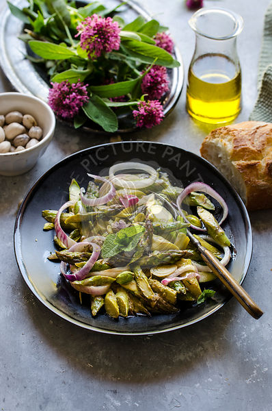 Asparagus salad with pistachio and red onion dressing