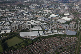Manchester aerial photograph of Trafford Park Industrial Estate with the Barton Dock Road and Merlin Park in the foreground looking towards the Village Way with Salford Quays Media City and Manchester United Football Stadium in the distance