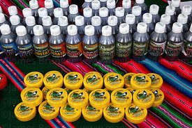 Creams for arthritis and bottles of various medicines on stall at trade fair promoting alternative products made from coca leaves , La Paz , Bolivia