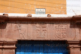 Stone carvings on lintel of colonial doorway, Maras, Cusco Region, Peru