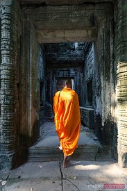 Buddhist monk walking into Angkor Wat temple, Cambodia