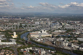 Manchester aerial photograph looking across from  Eccles town centre towards the Manchester Ship Canal running around the north side of Trafford Park Estate with Media City and Salford Quays with the Manchester United Football Stadium in the distance