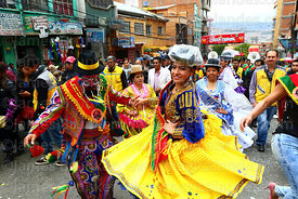 The official Ch'uta and cholita dancing during parades for the Entierro del Pepino, La Paz, Bolivia