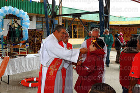 Former bishop of Arica Hector Vargas Bastides giving holy communion to devotee during mass for St Peter and St Paul festival, Arica, Chile