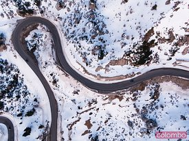 Aerial overhead view of winding mountain road