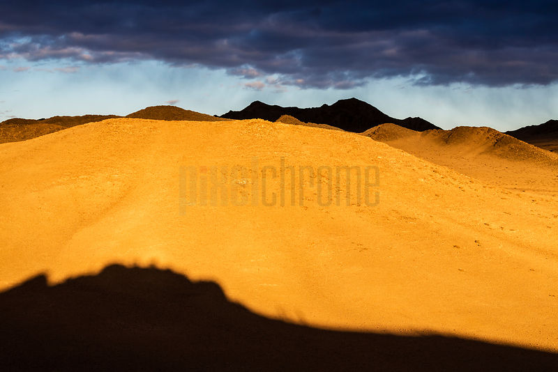 Mountainous Desert Landscape at Sunset