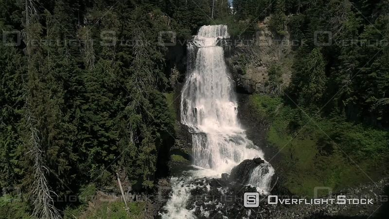 Drone footage of amazing cascading waterfall on sunny day in Canada