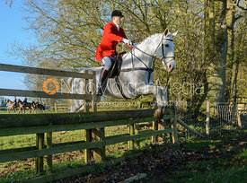 Nicholas Leeming MFH jumping a hunt jump in Pickwell