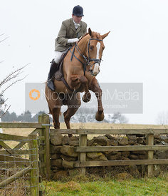 Rowan Cope jumping a wall at Goadby Hall