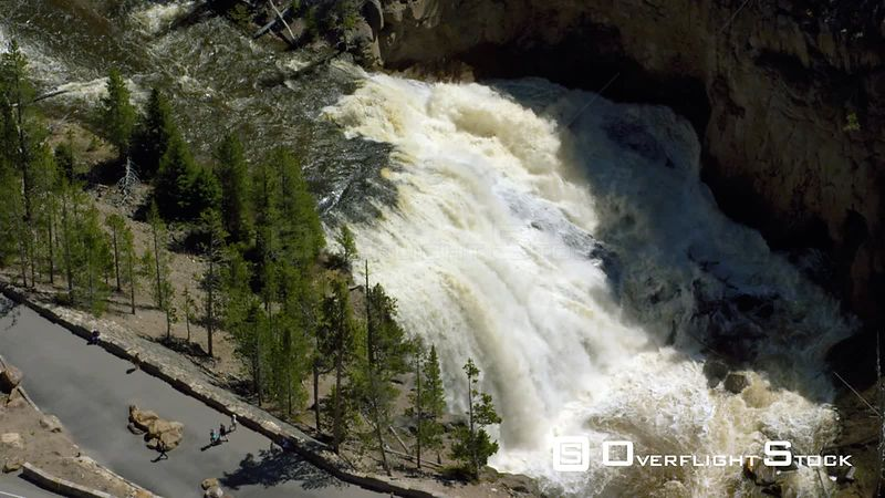 Gibbon Falls cascades over a dramatic rock formation in northwestern Yellowstone National Park. The falls are located near the confluence of the Gibbon and Firehole rivers