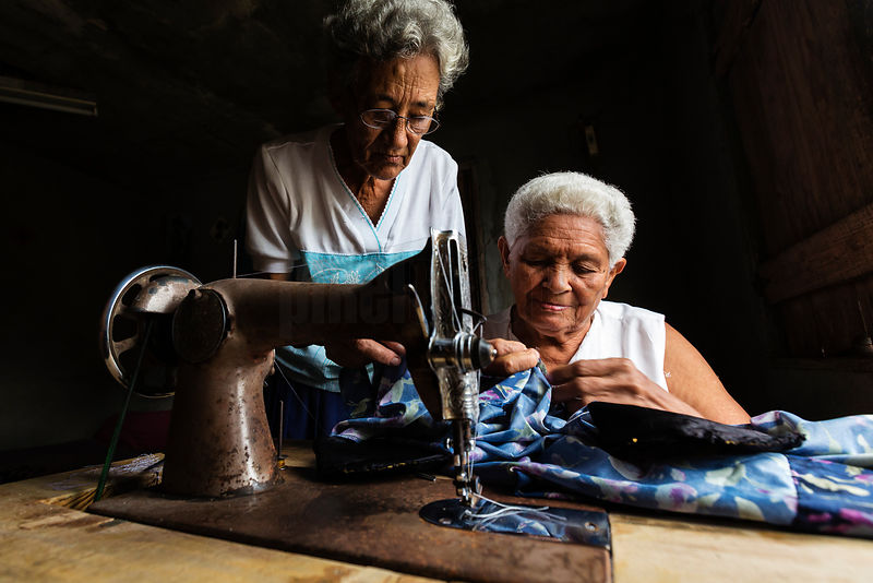 Elderly Women Sewing in Home