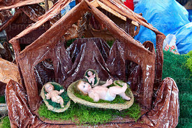Baby Jesus figures in manger for nativity scenes for sale in Christmas market, Bolivia