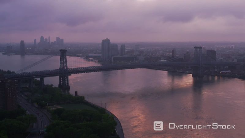 New York City Flying up East River by Williamsburg Bridge at sunrise.  Shot with Cineflex and RED EpicW Helium.