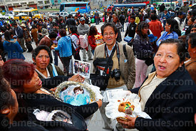Photographer with women holding baby Jesus figures outside church after mass for Reyes (Epiphany, January 6th), La Paz, Bolivia