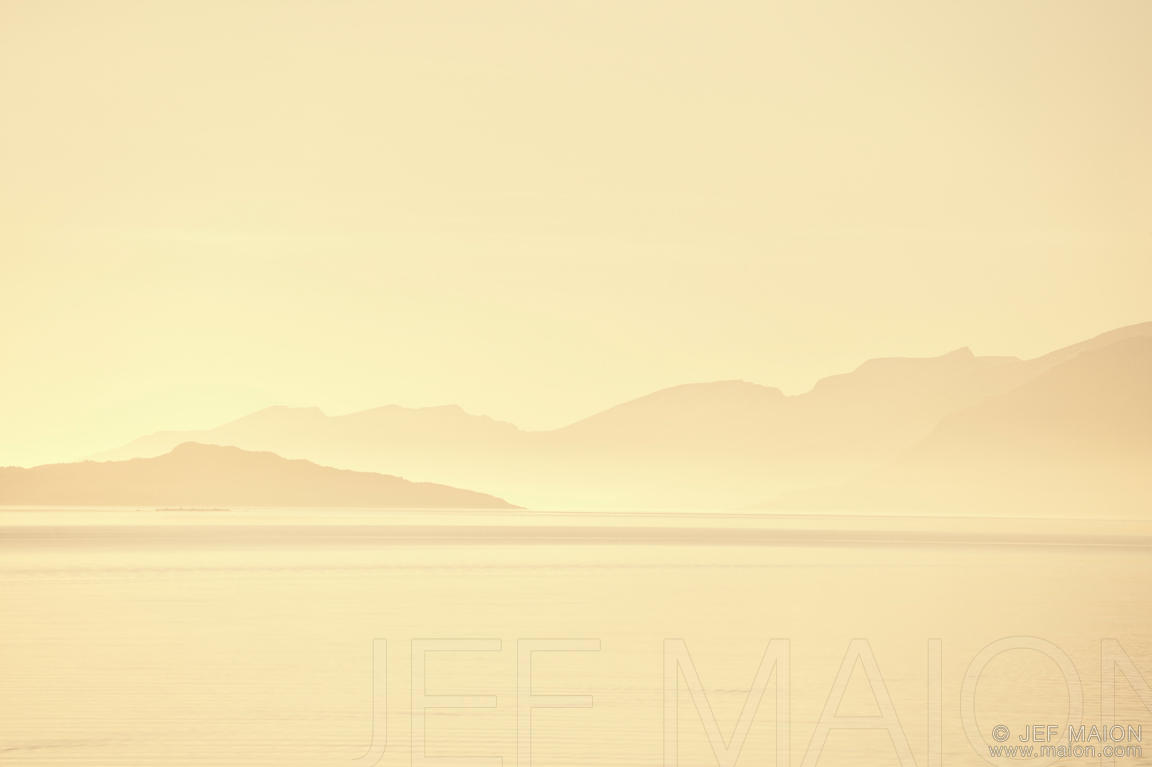 Beautiful warm morning light on sea and mountains
