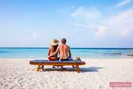 Couple on a beautiful sandy beach, Maldives