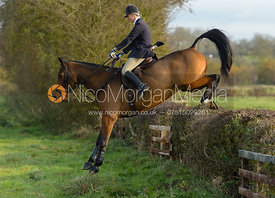Zoe Mossman jumping a hedge on Deane Bank