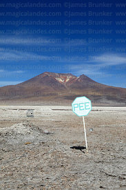 Pee sign on edge of Salar de Ascotan and Ascotan volcano, Region II, Chile