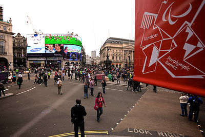 Street Scene in Picadilly Circus with a Paralympic Games Banner in the Foreground