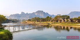Laos, Vang Vieng. Town and Nam Song river at sunrise