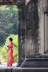Young woman wearing traditional Khmer dress in Angkor Wat