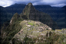 View of Inca city of Machu Picchu, Huayna Picchu peak and Urubamba canyon, Peru