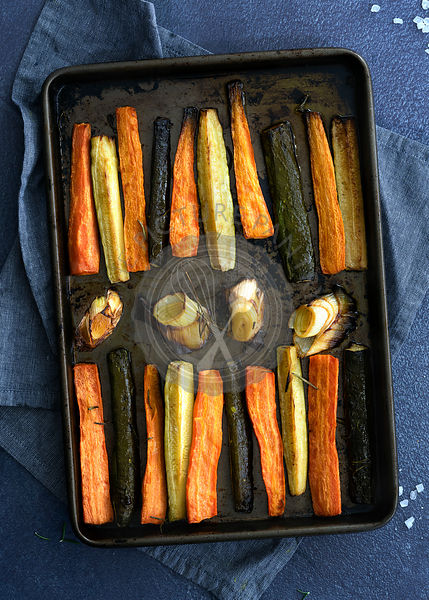 Roasted vegetables on a baking tray.