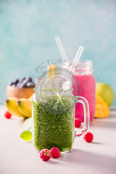 Close-up of fresh smoothie with fruits and berries, selective focus. Detox, dieting, clean eating, vegetarian, vegan, fitness, healthy lifestyle concept