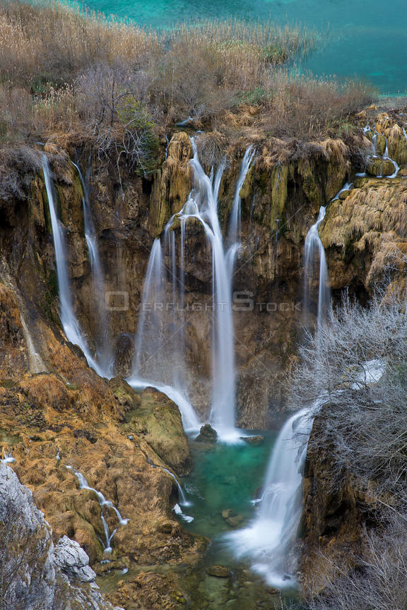 Waterfalls cascading between mountain lakes, Plitvice Lakes National Park, Croatia. January 2015.