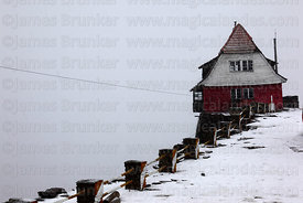 Old ski hut on Mt Chacaltaya in a blizzard, Cordillera Real, Bolivia