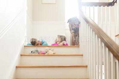 sisters young girls inside on stairs with dog2