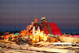 Aymara shamans or amautas watching offerings burning during Aymara New Year celebrations, Tiwanaku, Bolivia