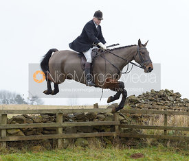 Harry Westropp jumping a wall at Goadby Hall