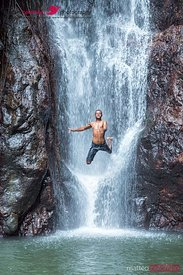 Local man jumping off a waterfall, Kadavu, Fiji