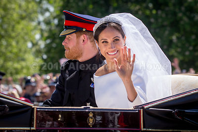 Duchess of Sussex, Meghan Markle, waving to the crowd during the royal couple's carriage ride