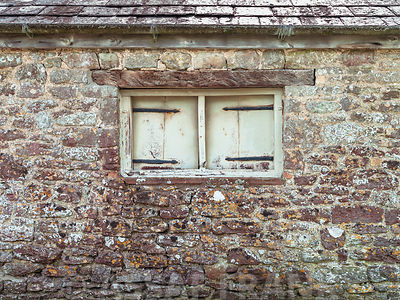 Old brick wall with vintage wooden window