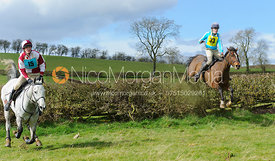 Archie Smyth-Osbourne and Harriet Gibson jumping the last hedge - Harborough Ride 2014