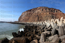 Concrete tetrapod revetment structures preventing coastal erosion and El Morro headland, Arica, Region XV, Chile